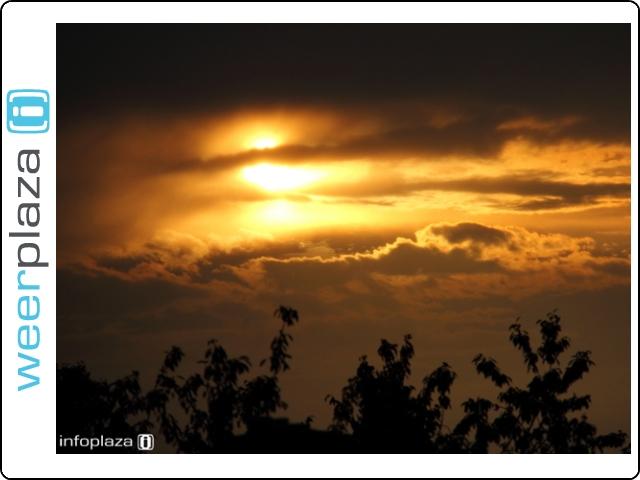 Schouwspel zon en bui
